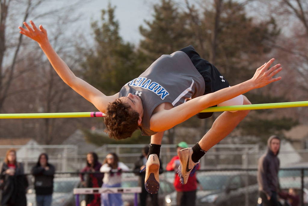 . Joey Bratkovich of Midview arches his back and clears the bar in the boys high jump at the Lorain County Invitational Track Meet. Jen Forbus -- The Morning Journal