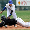 Longmont's Julian Moroyoqui tags out Silver Creek's Wyatt Knechtel at second during their game at Silver Creek in Longmont, Colorado April 16, 2010.  CAMERA/Mark Leffingwell