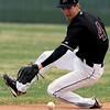 Silver Creek's Eric Van Dyke makes a sliding stop during their game at Silver Creek in Longmont, Colorado April 16, 2010.  CAMERA/Mark Leffingwell