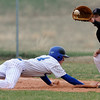 Longmont's Griffin Phillips slides safely back to first as Silver Creek's Ryan Schram catches the ball during their game at Silver Creek in Longmont, Colorado April 16, 2010.  CAMERA/Mark Leffingwell