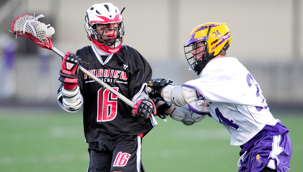 Fairview's Will Kinnard (left) gets shoved by Boulder's Griffin Bohn (right) during their lacrosse game at Recht Field in Boulder, Colorado April 14, 2011.  CAMERA/Mark Leffingwell