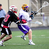 Fairview's Sean LaVine (left) collides with Boulder's Griffin Bohn (right) during their lacrosse game at Recht Field in Boulder, Colorado April 14, 2011.  CAMERA/Mark Leffingwell