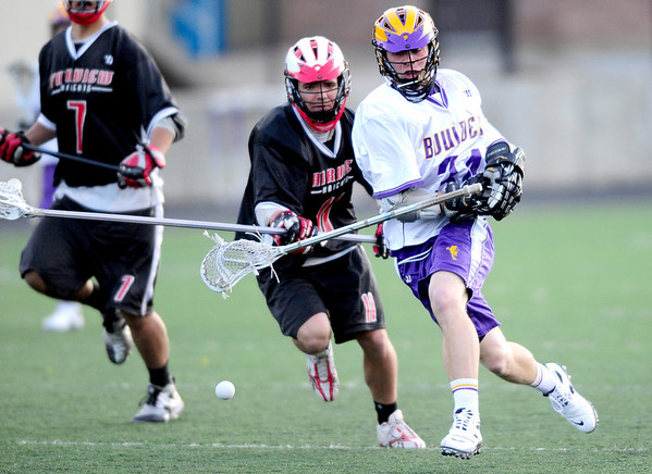 Boulder's Griffin Bohm (right) and Fairview's Zach Marriner (left) race for the ball during their lacrosse game at Recht Field in Boulder,Colorado April 14, 2011.  CAMERA/Mark Leffingwell