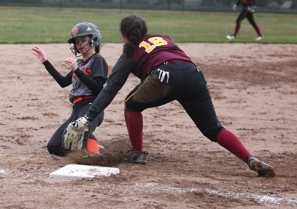 . Avon Lake third baseman Kassidy Melton tags out Abby Rigda of North Olmsted. Randy Meyers -- The Morning Journal