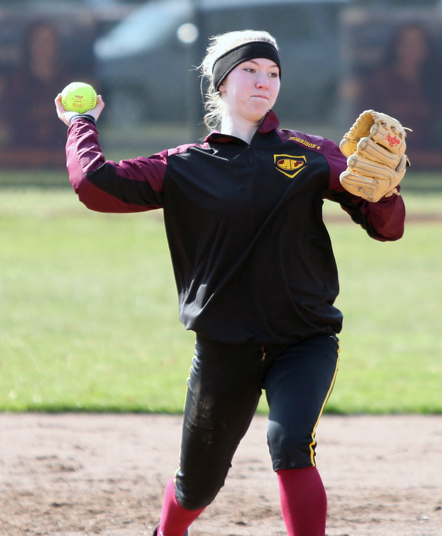 . Avon Lake shortstop Miranda Morrison fields a ground ball and throws to first for the out against North Olmsted. Randy Meyers -- The Morning Journal
