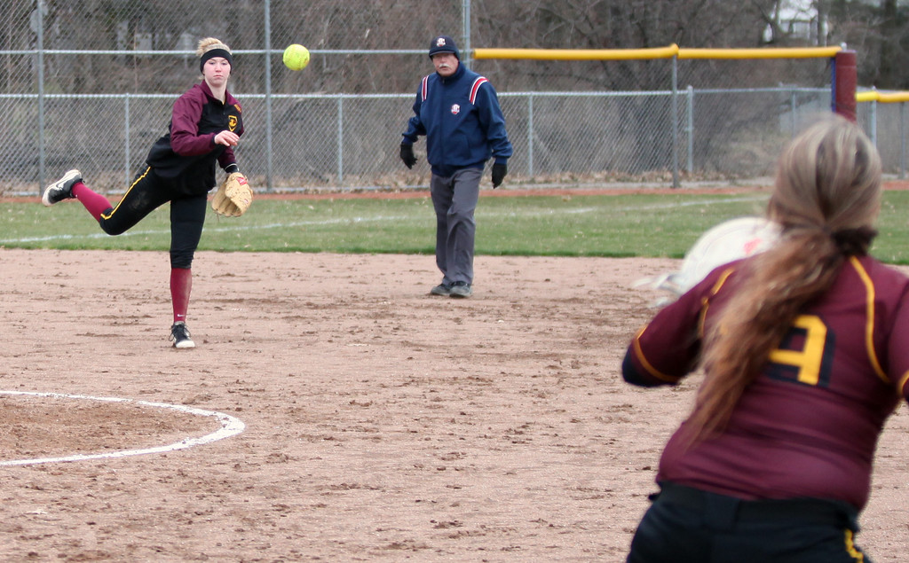 . Avon Lake shortstop Miranda Morrison throws to Gwen Lester at first for the out against North Olmsted. Randy Meyers -- The Morning Journal
