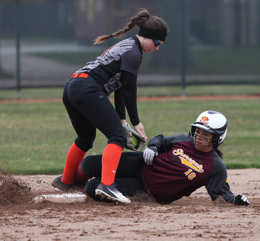 . Abby Rigda of North Olmsted tags out Kassidy Merlton of Avon Lake at second base. Randy Meyers -- The Morning Journal