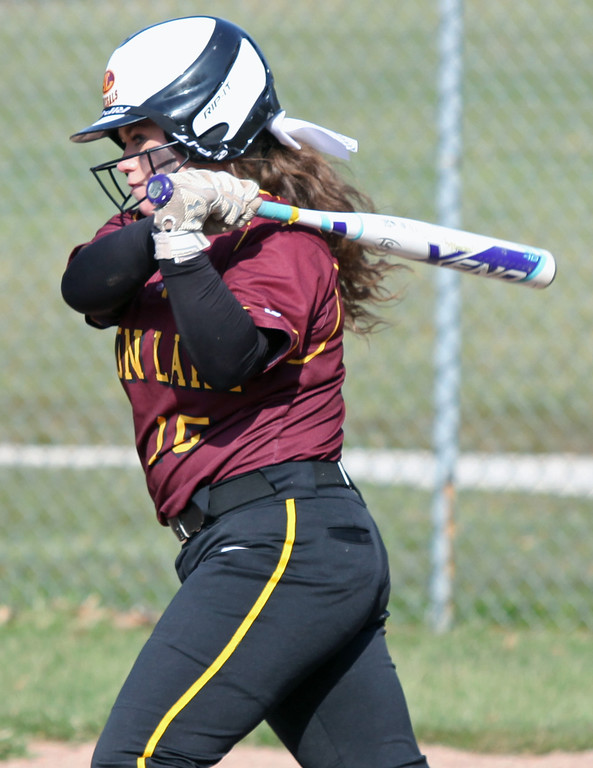 . Paige Schwark of Avon Lake lines a hit against North Olmsted. Randy Meyers -- The Morning Journal