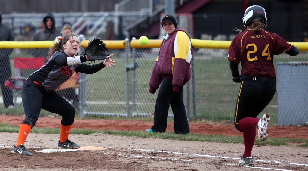 . Grace Laurenzi of North Olmsted takes the throw at first for the out as Avon Lake\'s Sydney Petonic runs down the line. Randy Meyers -- The Morning Journal