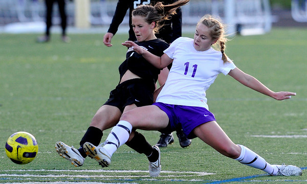 Boulder's Maddie Barber (right) and Fairview's Olivia Fear (left) fight for the ball during their soccer game at Recht Field in Boulder, Colorado April 19, 2011.  CAMERA/Mark Leffingwell