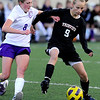 Fairview's Kristin Breakell (right) keeps Boulder's Lucy Jacobson (left) from the ball during their soccer game at Recht Field in Boulder, Colorado April 19, 2011.  CAMERA/Mark Leffingwell