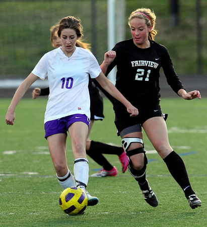 Boulder's Adrienne Lowney kicks the ball away from Fairview's Berkley Gamble during their soccer game at Recht Field in Boulder, Colorado April 19, 2011.  CAMERA/Mark Leffingwell