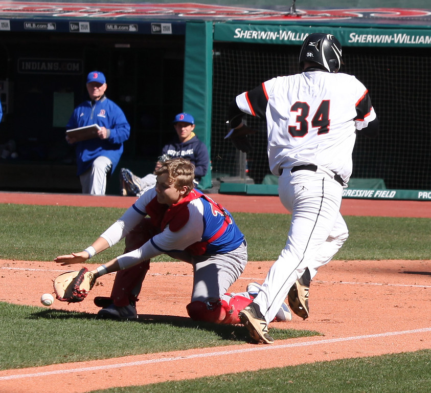 . Bay catcher Logan LaMere loses the ball near homeplate as Cam Shreves of Eastlake North scores. Randy Meyers -- The Morning Journal