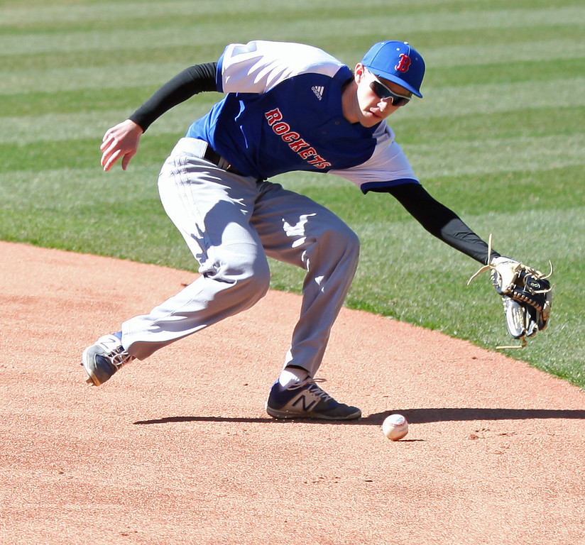 . Bay second baseman Truman Ospelt reaches for a ground ball against Eastlake North. Randy Meyers -- The Morning Journal
