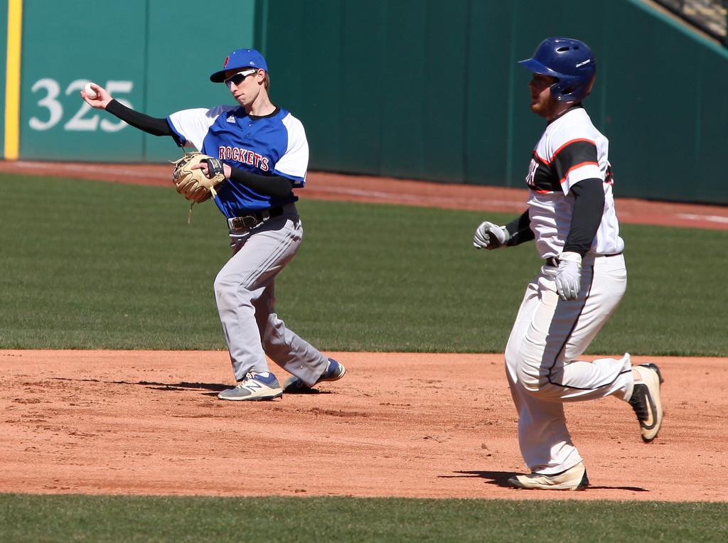 . Bay\'s Truman Ospelt spins and throws to second for the force on Ben Goerndt of Eastlake North during the Hardball Classic. Randy Meyers -- The Morning Journal