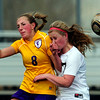 Monarch's Megan Lacy (right) and Boulder's Camille Wasinger (left) collide going for the ball during their soccer game at Monarch High School in Louisville, Colorado April 26, 2011.  CAMERA/Mark Leffingwell