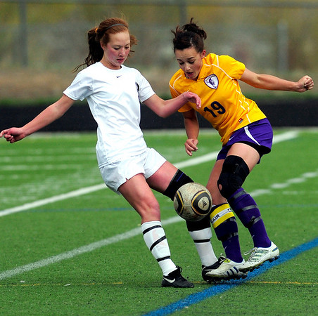 Monarch's Phoebe Szeton (left) tries to get the ball from Boulder's Katlyn Lokay (right) during their soccer game at Monarch High School in Louisville, Colorado April 26, 2011.  CAMERA/Mark Leffingwell
