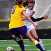 Monarch's Cassie Owens (left) dodges around Boulder's Camille Wasinger (right) during their soccer game at Monarch High School in Louisville, Colorado April 26, 2011.  CAMERA/Mark Leffingwell