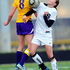 Boulder's Camille Wasinger (left) and Monarch's Cassie Owens (right) collide going for the ball during their soccer game at Monarch High School in Louisville, Colorado April 26, 2011.  CAMERA/Mark Leffingwell