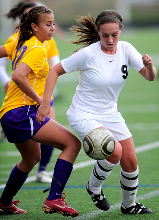 Monarch's Liesel Schiffenhauer (left) blocs Boulder's Zoe Dulchinos (right) from the ball during their soccer game at Monarch High School in Louisville, Colorado April 26, 2011.  CAMERA/Mark Leffingwell
