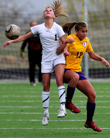 Monarch's Brenna Stimac (left) knocks the ball from Boulder's Zoe Dulchinos (right) during their soccer game at Monarch High School in Louisville, Colorado April 26, 2011.  CAMERA/Mark Leffingwell