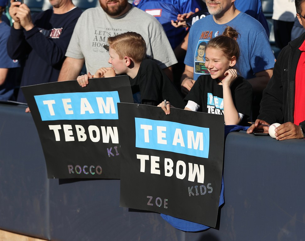 . Tim Phillis - The News-Herald Fans cheer on Tim Tebow of Double-A Binghamton on April 30 at Canal Park in Akron.