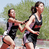 (L-R) Danielle Varela hands the baton off to Jennifer Gutierrez during the 400x100m relay at the state track and field AA championships, held in Albuquerque, N.M., on May 6, 2010.<br /> Natalie Guillén/The New Mexican