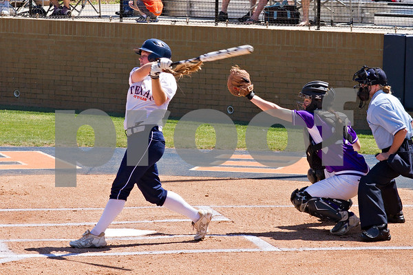 Photo by Shannon Wilson / Tyler Morning Telegraph UT Tyler softball player Ashley Endsley (9) swings at a pitch during the 2013 NCAA Softball Championships at UT Tyler Ballpark.