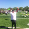 John Kampf - The News-Herald<br /> Sandra Johnson raises her arms in triumph after completing the SELebrate Moms 5K on May 13.