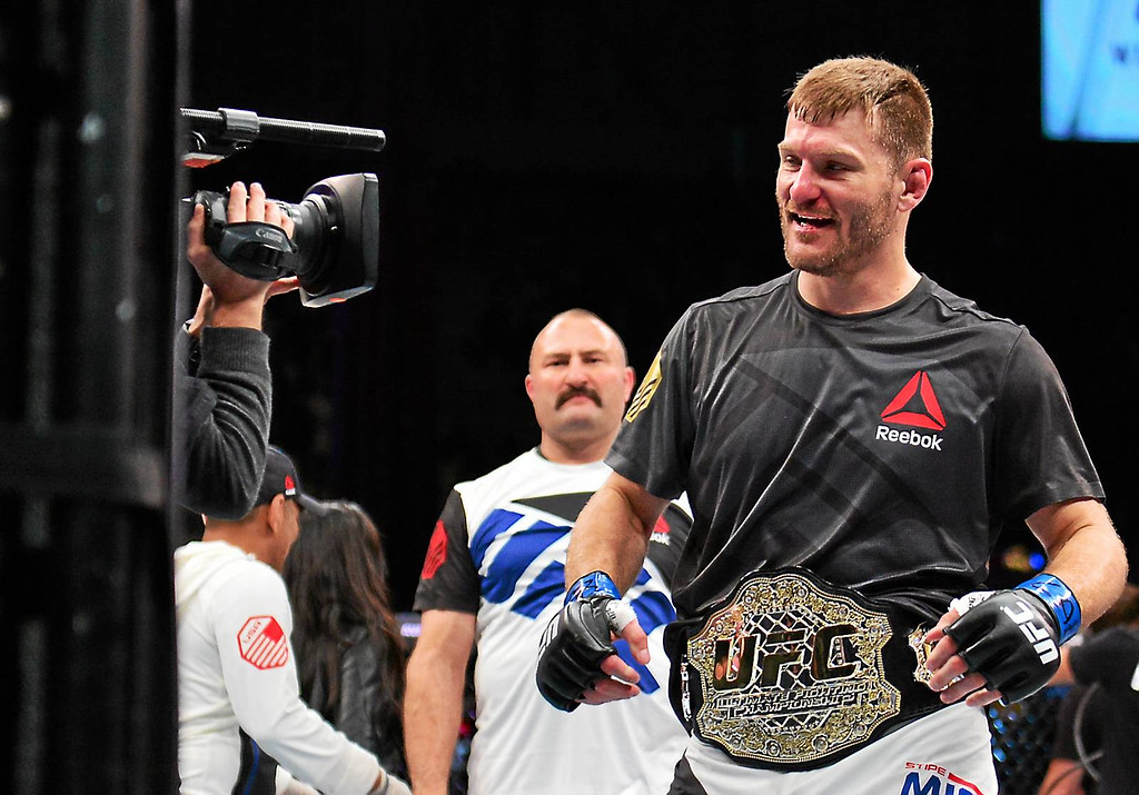 . Associated Press Stipe Miocic shows off his championship belt after knocking out heavyweight champion Fabricio Werdum May 14 at UFC 198.