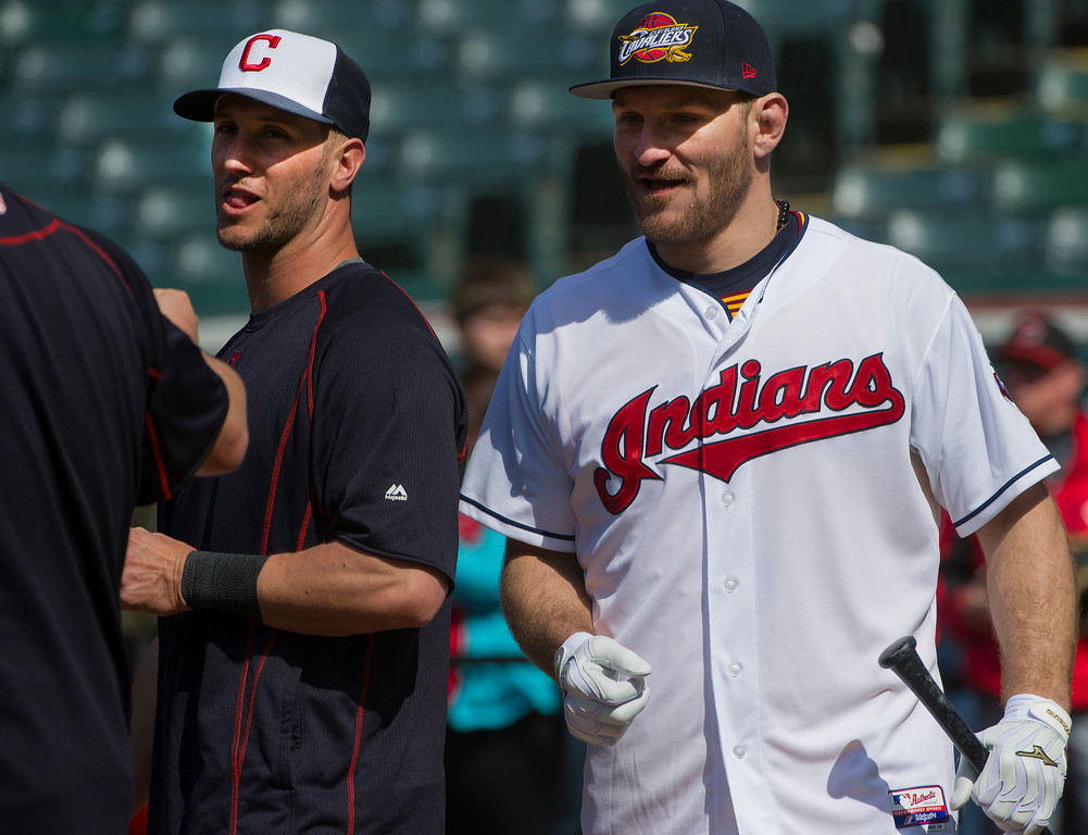 . UFC Heavyweight Champ Stipe Miocic, right, a Cleveland native, talks with Cleveland Indians catcher Yan Gomes, left, after taking batting practice with the Indians, before a baseball game against the Cincinnati Reds, in Cleveland, Tuesday, May 17, 2016. Miicic beat Brazilian Fabricio Werdum Saturday night for the crown. (AP Photo/Phil Long)