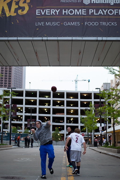 . Michael Johnson - The News-Herald Zachary Woods throws a football to his siblings outside of the Quicken Loans Arena during the Eastern Conference Finals game 2 watch party on May 15, 2018.