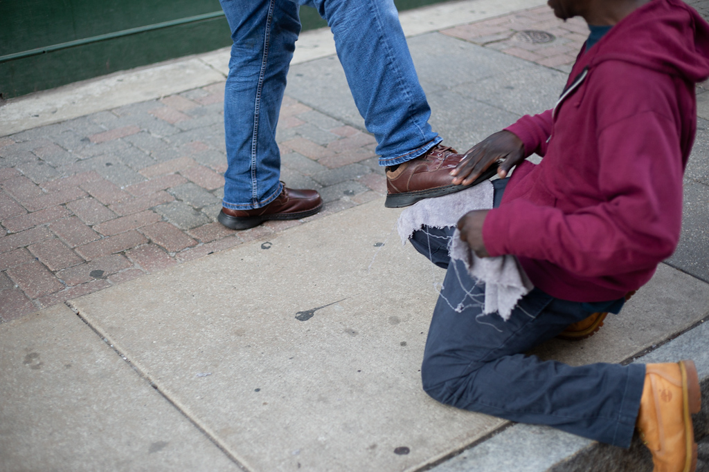 . Michael Johnson - The News-Herald A man has his shoes shined outside of the Quicken Loans Arena on May 15, 2018.