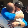 (Mark Podolski - News-Herald) Stipe Miocic and his coach Marcus Marinelli share a hug on May 16 at Strong Style in Independence.