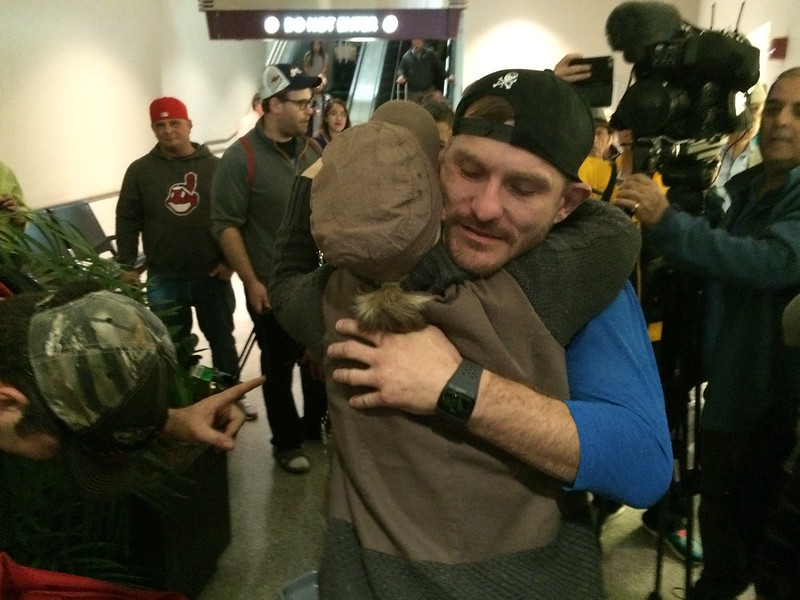 (Mark Podolski - News-Herald) Stipe Miocic hugs friend Anna Sweetnich upon his arrival at Cleveland Hopkins Airport on May 16.