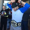 (Mark Podolski - News-Herald) UFC champion Stipe Miocic shows off his title belt on May 16.