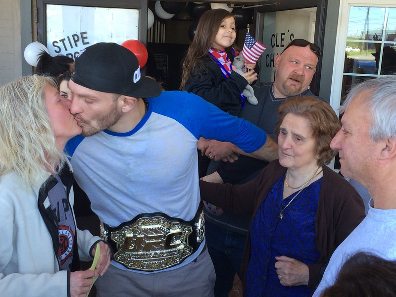 (Mark Podolski - News-Herald) Stipe Miocic kisses his mother, Kathy Miocic, left, on May 16.