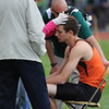 20110520_TRACK_ERIE_SOLOMON.JPG Trainers treat Erie's Mitchel Solomon after he hit his head on an upright during 4A high jump at the State Track and Field Championships Friday May 20, 2011 at Jefferson County Stadium. Solomon went on to finish with a third place medal. (Lewis Geyer/Times-Call)