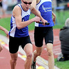 Lyons' Zach Pfeifer (right) passes the baton to Chris Smith (left) in the 3A Boys 4x800 during the State Track and Field Championships at Jefferson County Stadium in Lakewood, Colorado May 20, 2011.  CAMERA/Mark Leffingwell