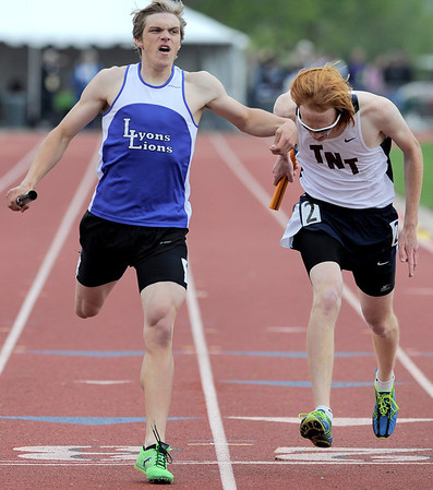 Lyons' Ryan Boucher (left) crosses the finish line just ahead of runner from Telluride High School's Colten Rogers (right) winning the 3A Boys 4x800 during the State Track and Field Championships at Jefferson County Stadium in Lakewood, Colorado May 20, 2011.  CAMERA/Mark Leffingwell