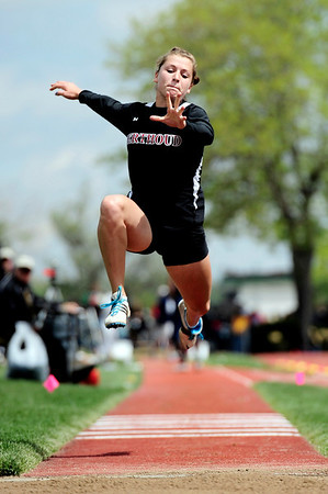 Berthoud's Courtney Mills leaps in the triple jump during the State Track and Field Championships at Jefferson County Stadium in Lakewood, Colorado May 20, 2011.  CAMERA/Mark Leffingwell