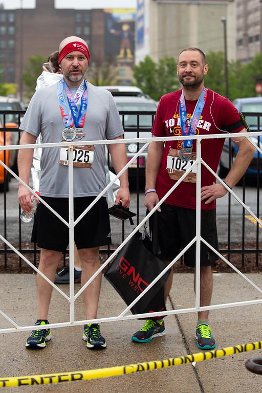 . Michael Johnson - The News-Herald Anthony Spies and Mike Nagorka pose for a portrait at the Cleveland Marathon on May 20, 2018.
