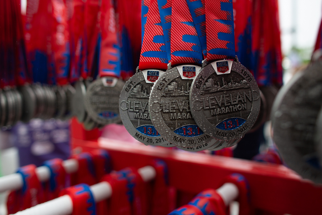 . Michael Johnson - The News-Herald Metals sit ready to be handed out to marathon participants in Cleveland on May 20, 2018.