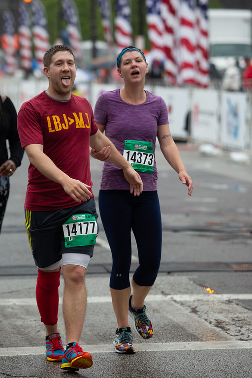 . Michael Johnson - The News-Herald Ryan Hillman and Tracey Patterson cross the finish line after running a 10 K during the Cleveland Marathon on May 20, 2018.