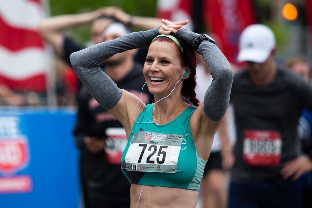 . Michael Johnson - The News-Herald Stephanie Lesko smiles after crossing the finishline