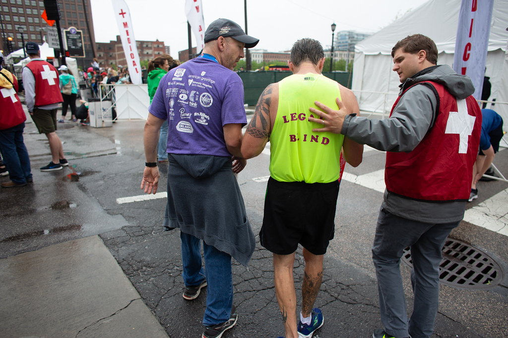 . Michael Johnson - The News-Herald Medical staff checks out a legally blind man after he ran the 10k race in Cleveland on May 20, 2018.
