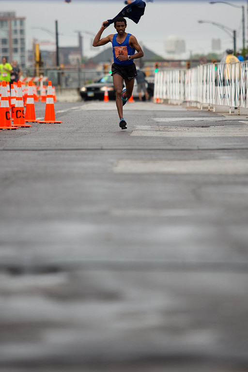 . Michael Johnson - The News-Herald Daniel Mesfun was the first to run toward the finishline of the Cleveland Marathon on May 20, 2018.