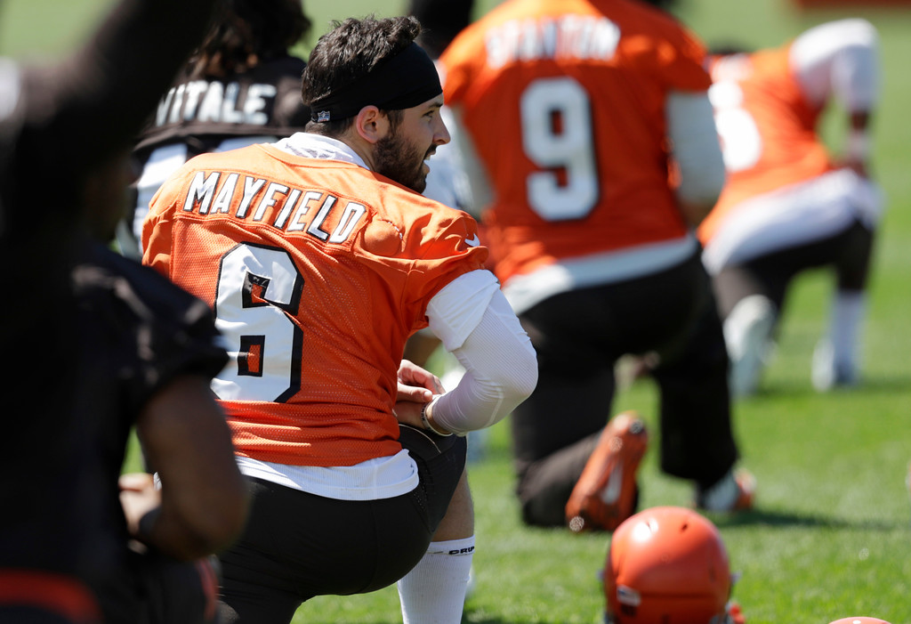 . Cleveland Browns quarterback Baker Mayfield stretches during a practice at the NFL football team\'s training camp facility, Wednesday, May 23, 2018, in Berea, Ohio. (AP Photo/Tony Dejak)