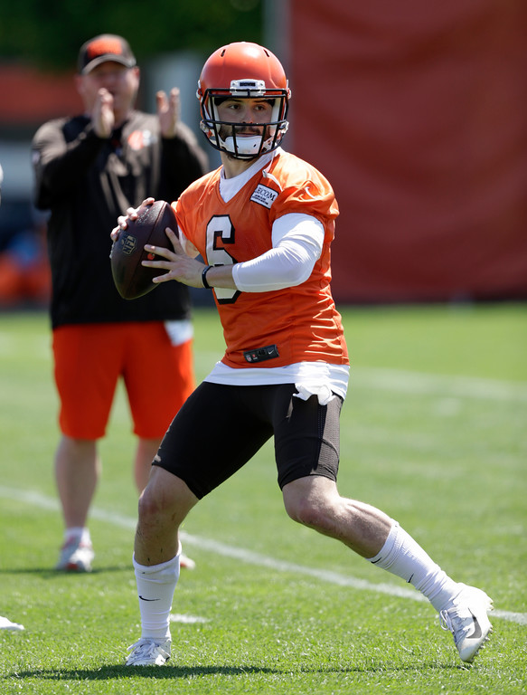 . Cleveland Browns quarterback Baker Mayfield looks to throw during a practice at the NFL football team\'s training camp facility, Wednesday, May 23, 2018, in Berea, Ohio. (AP Photo/Tony Dejak)