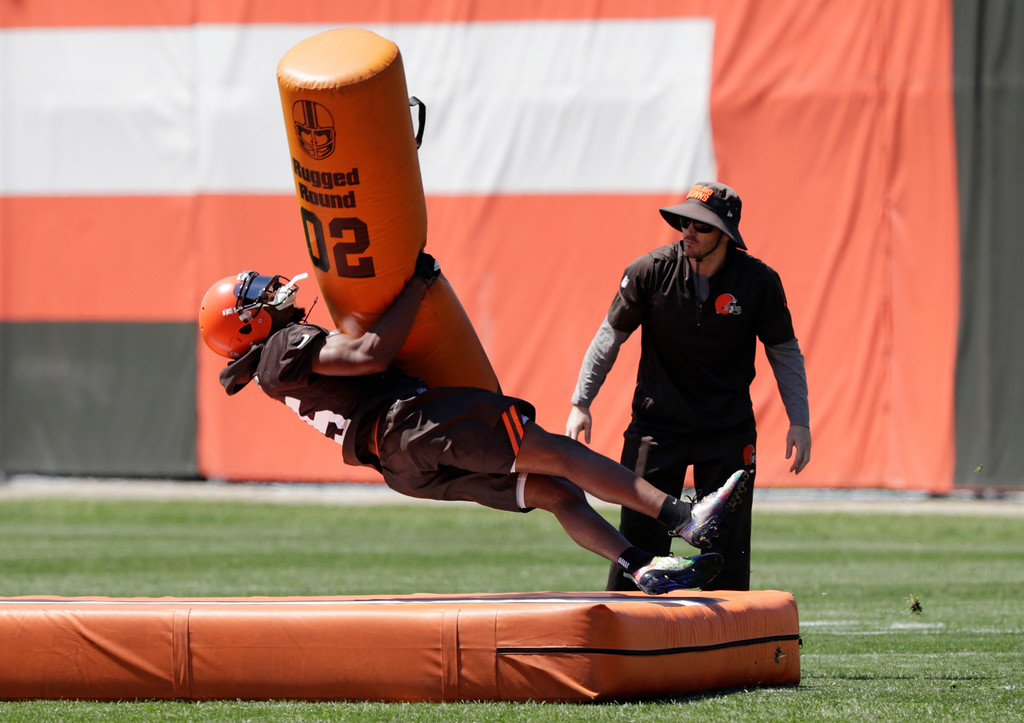 . Cleveland Browns wide receiver Ricardo Louis tackles a tackling dummy during a practice at the NFL football team\'s training camp facility, Wednesday, May 23, 2018, in Berea, Ohio. (AP Photo/Tony Dejak)